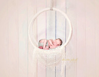 Baby sleeping on a sheer lace artisan swing